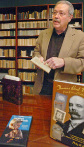 "Phil Bishop holds the book used in the movie ""the Secret Life of Words."" In the forefront are the DVD and Bishop's bibliography of Mosher books."
